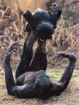 Lana balancing baby Photograph by Frans Lanting 1997