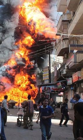 Exploding building in Aleppo, Syria