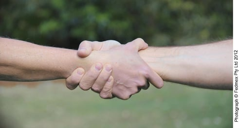 """""""love, which binds them all together in perfect unity"""" (Col. 3:14) - two hands clasped together"""