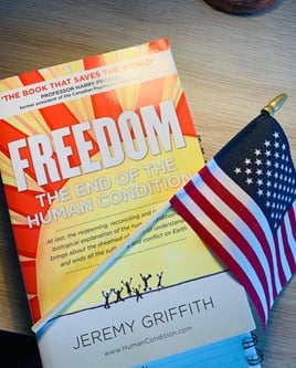 FREEDOM book next to USA flag